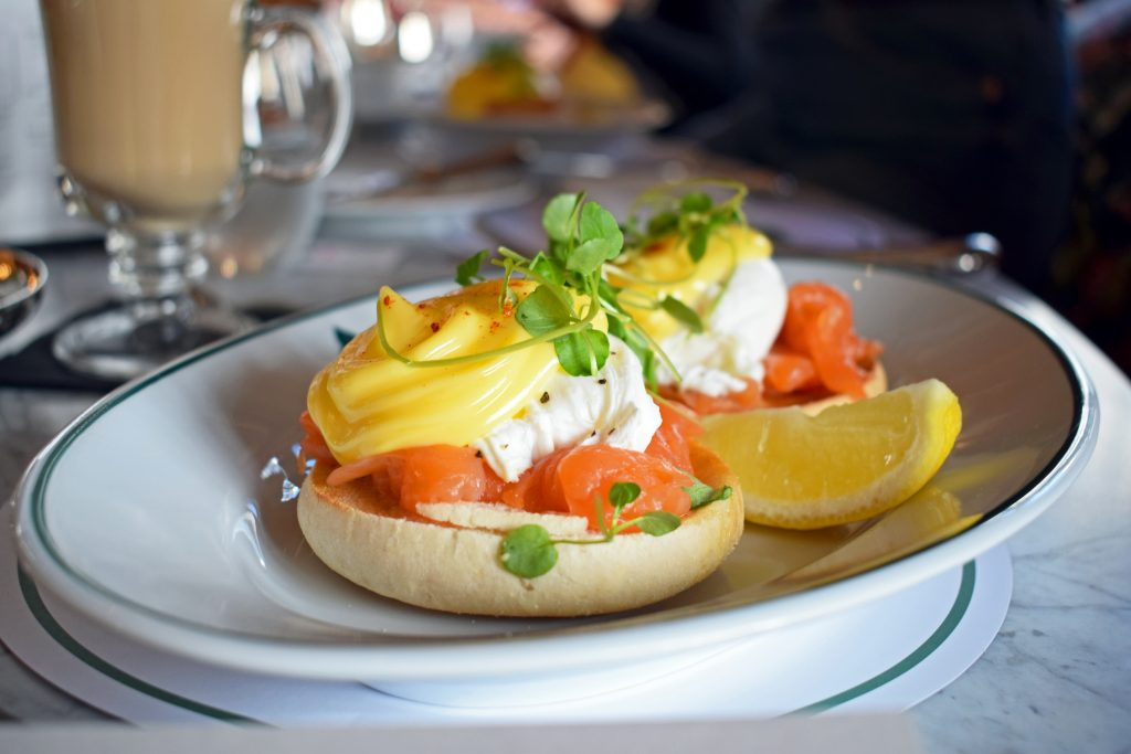 Breakfast at The Ivy: Eggs Royale with a wedge of lemon